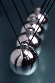 Newton's Cradle, a well known physics demonstration tool showing the conservation of momentum